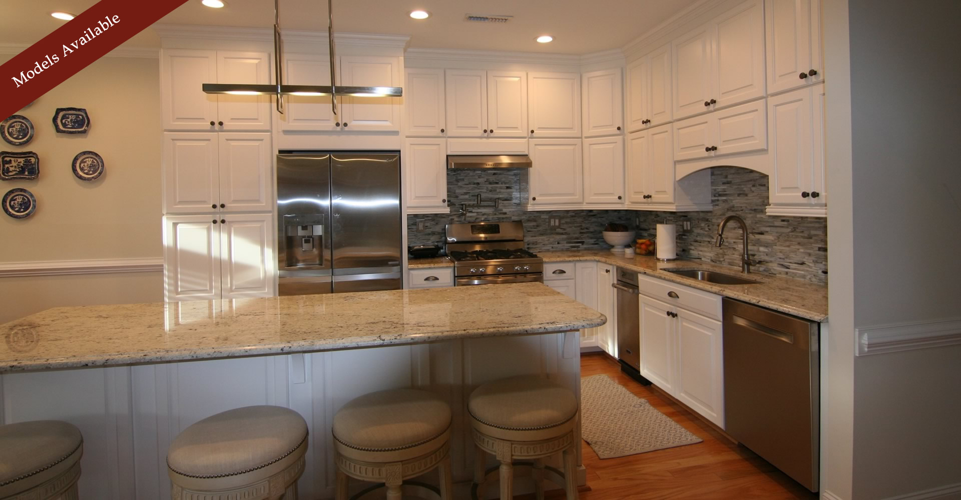Large kitchen with wine cooler, granite countertop, island.