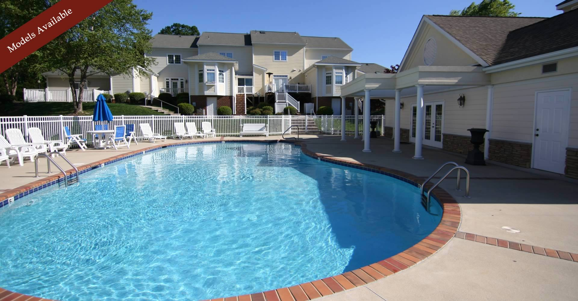 Luxury townhome community's swimming pool and clubhouse for entertaining